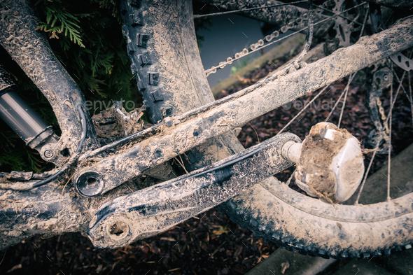 Mountain biking, dirty and broken bicycle closeup - Stock Photo - Images