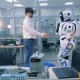 An Engineer in Augmented Reality Glasses and a Robot Are Shaking Hands - VideoHive Item for Sale