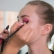 Makeup Artist Applying Makeup Products on a Beautiful Model in Studio before Photoshooting - VideoHive Item for Sale