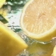 Lemon Hits Orange Juice Surface and Splits into Halves - VideoHive Item for Sale