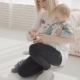Young Mother Put on Shoes To Her Lovely Baby. Happy Family. - VideoHive Item for Sale
