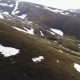 Flight over Mountain Slopes without Vegetation with Snow-covered Areas - VideoHive Item for Sale