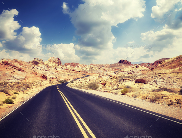 Vintage toned picture of a desert road. - Stock Photo - Images
