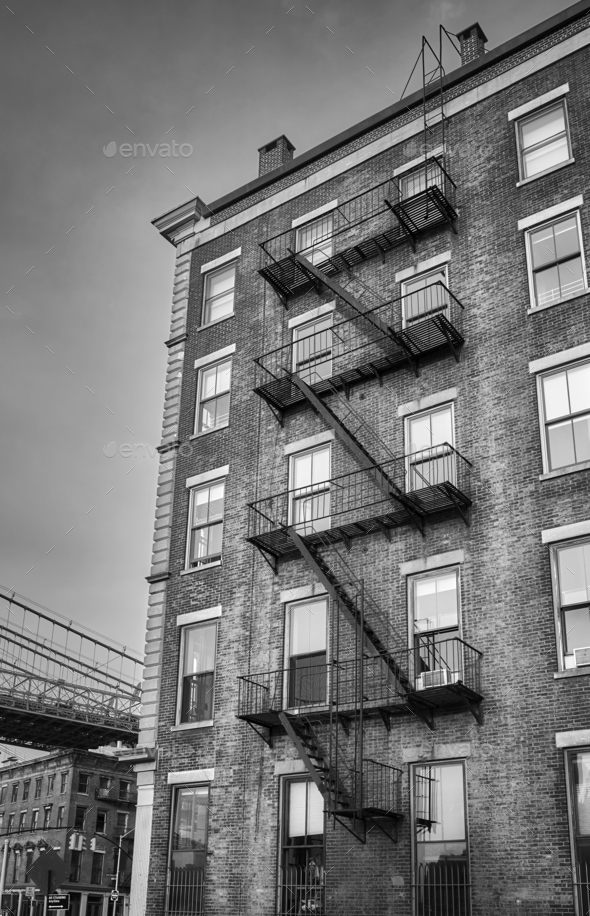 Old building with fire escape, NYC. - Stock Photo - Images
