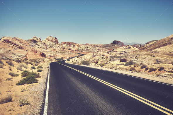 Retro stylized picture of a desert road. - Stock Photo - Images