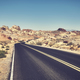Retro stylized picture of a desert road. - PhotoDune Item for Sale