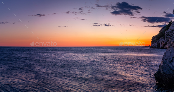 Beautiful sunset over the cliffs in Petrovac - Stock Photo - Images