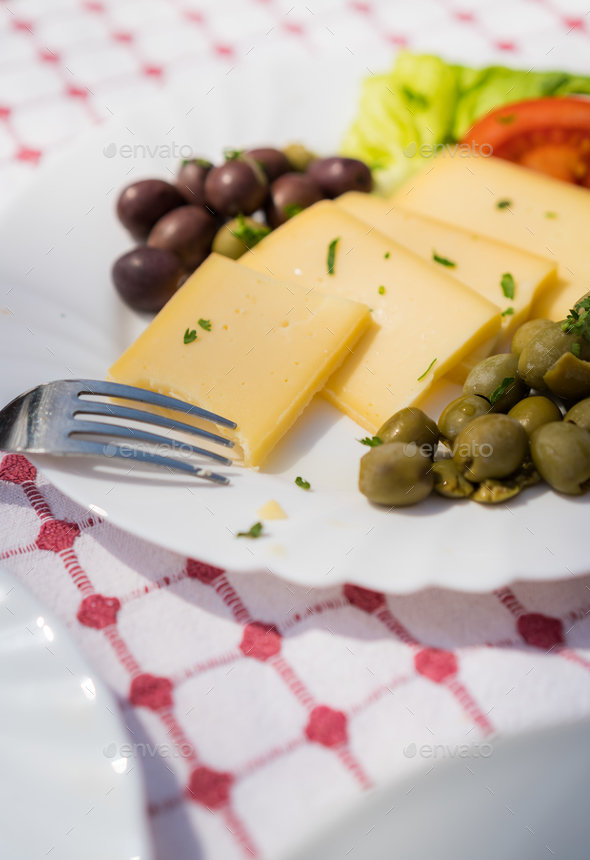 Summer salad with olives, tomatoes and cheese - Stock Photo - Images