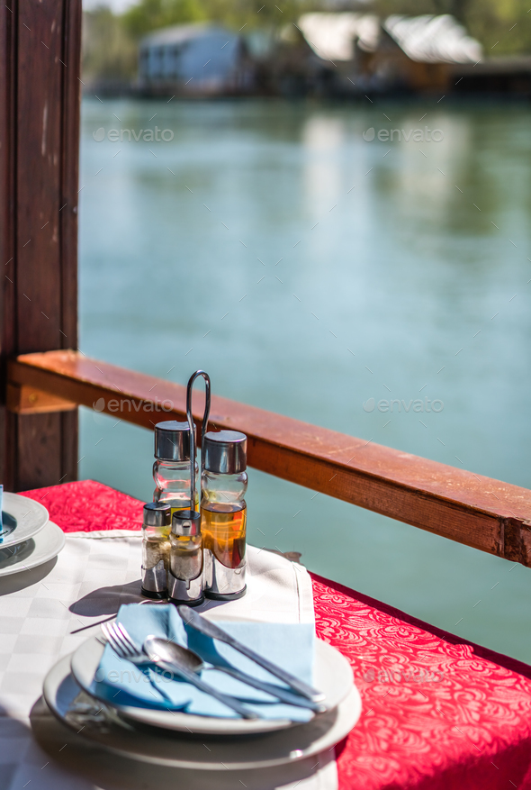 Wooden riverside restaurant in Ada Bojana - Stock Photo - Images