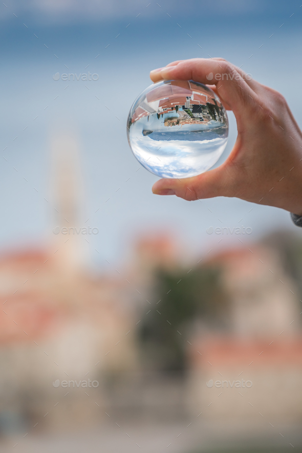 Budva reflected in a glass ball - Stock Photo - Images