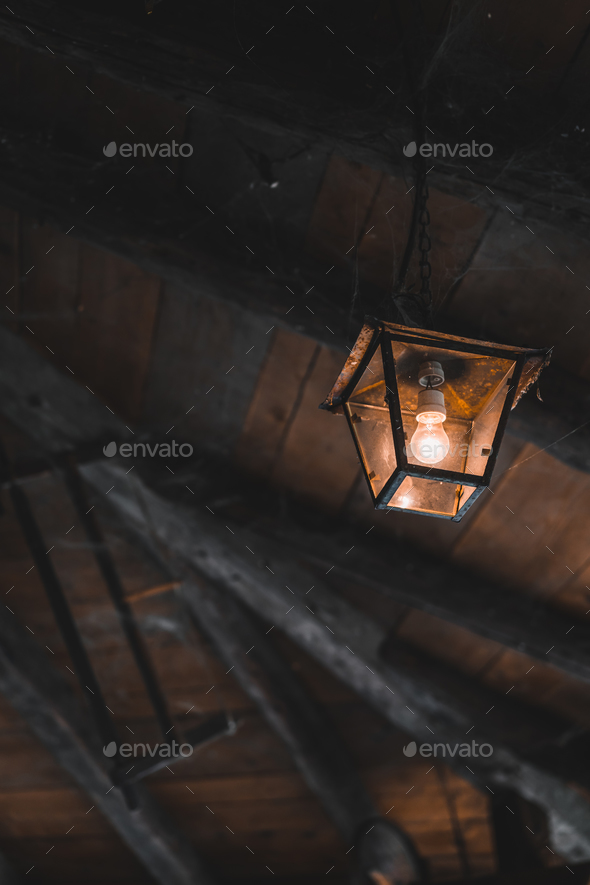 Old lamp in a shed - Stock Photo - Images