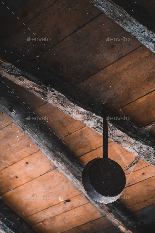Old frying pan hanging in a shed - Stock Photo - Images