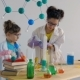 Teenagers Play in Chemistry with Bright Color Liquids - VideoHive Item for Sale