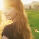 Happy Ginger Girl Walking and Looking Into Camera at Sunset in Summer Park - VideoHive Item for Sale