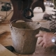 Man's Hand Is Taking a Metal Bucket To Start Working. Repairing Room with All the Construction - VideoHive Item for Sale