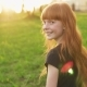 Little Beautiful Redhead Girl Goes To Meet Sun and Looks Into Camera - VideoHive Item for Sale