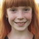 Face of Happy Ginger Girl with Freckles on Blurred Background - VideoHive Item for Sale