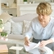 Senior Woman Writing On a Piece of Paper, Elderly Woman Writing a Letter - VideoHive Item for Sale