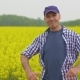 Successful Farmer on Rape Seed Field - VideoHive Item for Sale