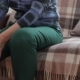 Elderly Woman Having Pain in His Knee Is Sitting on the Sofa,  Video - VideoHive Item for Sale