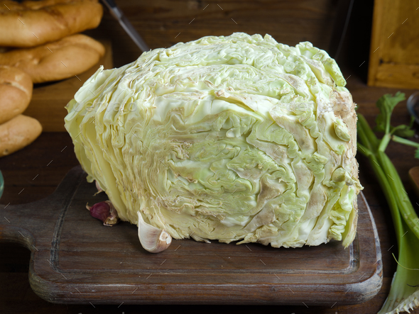 cabbage garlic and oil on rustic wood - Stock Photo - Images