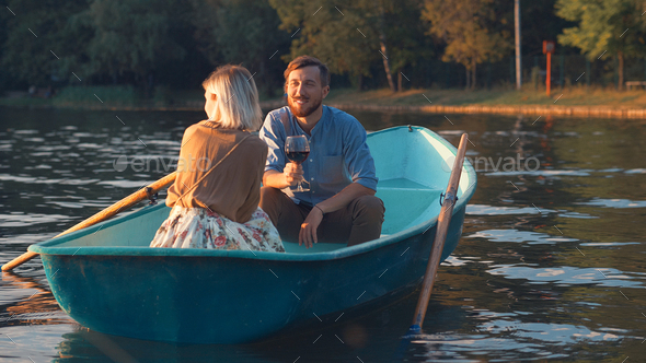 Young couple in a boat outdoors - Stock Photo - Images