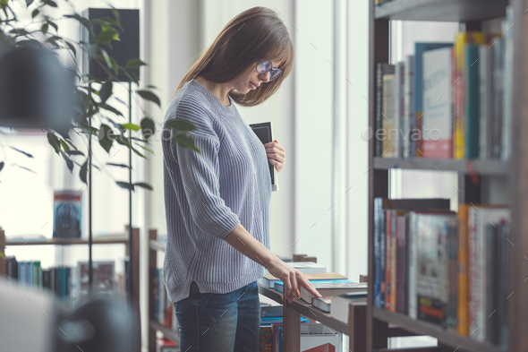 Attractive woman with books - Stock Photo - Images