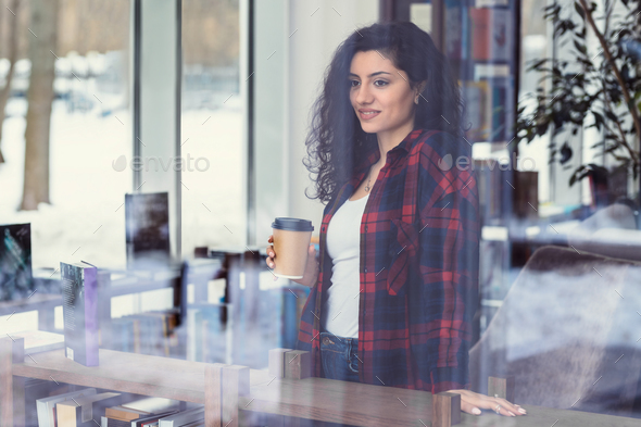 Attractive woman in the library - Stock Photo - Images