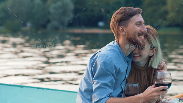 Happy couple in a boat - Stock Photo - Images