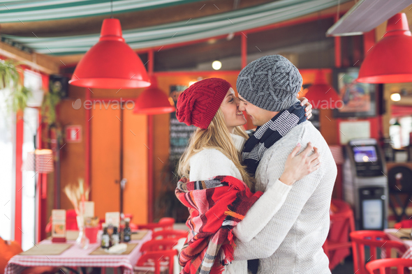 Kissing young couple on a date - Stock Photo - Images