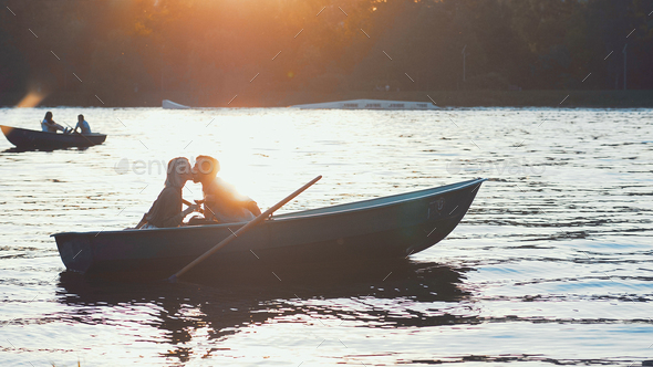 Kissing couple at sunset - Stock Photo - Images