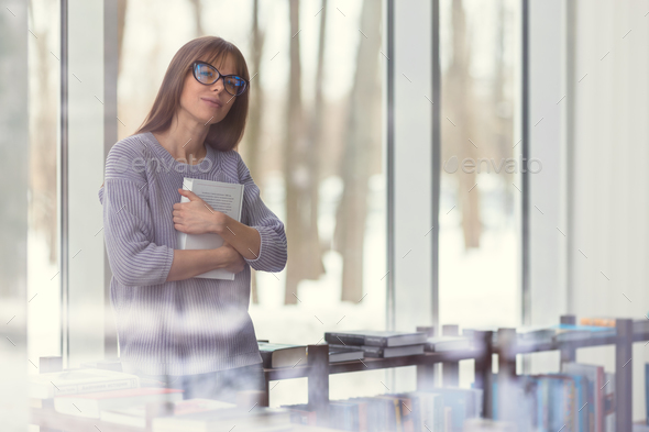 Young student with book - Stock Photo - Images
