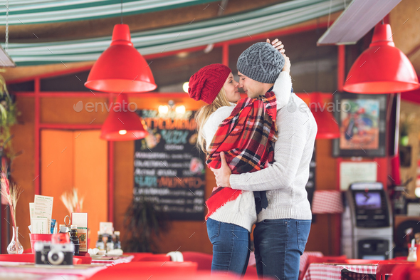 Kissing couple on a date - Stock Photo - Images