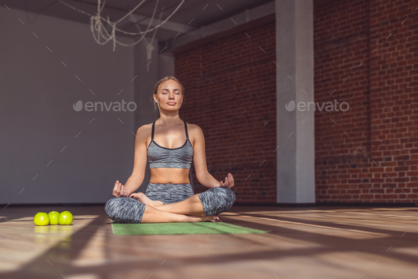 Young instructor doing yoga - Stock Photo - Images
