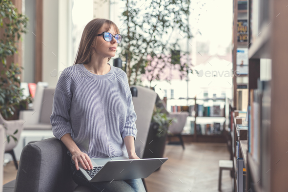 Young student with laptop - Stock Photo - Images