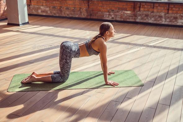 Young girl doing yoga - Stock Photo - Images