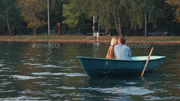 Romantic couple in a boat - Stock Photo - Images