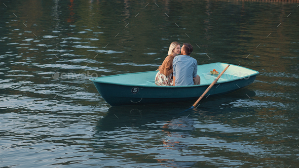 Romantic couple on the lake - Stock Photo - Images