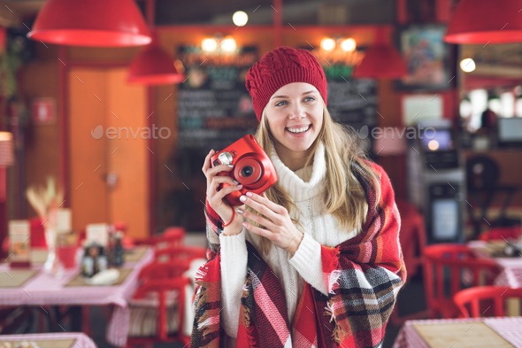 Happy attractive woman with a red polaroid - Stock Photo - Images