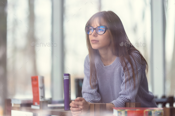 Young student in the library - Stock Photo - Images