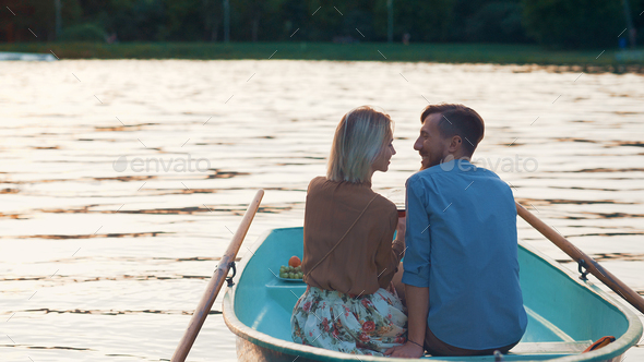 Young couple at the lake - Stock Photo - Images