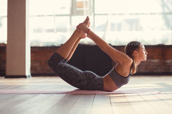 Attractive girl practicing yoga - Stock Photo - Images