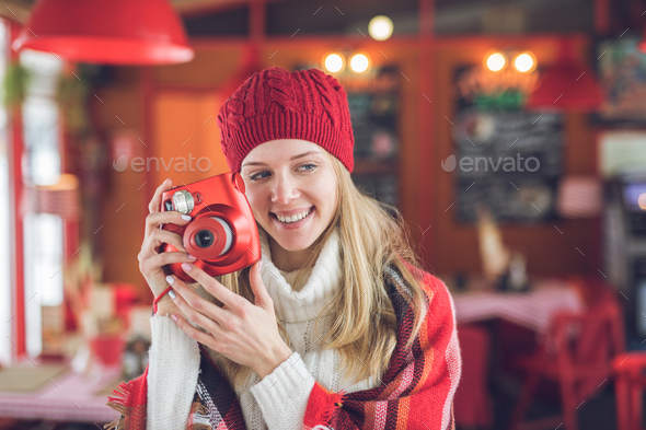 Smiling attractive woman with a red polaroid - Stock Photo - Images