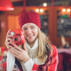 Smiling attractive woman with a red polaroid - PhotoDune Item for Sale
