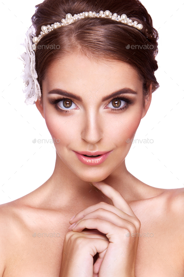Portrait of a beautiful woman with flowers in her hair. - Stock Photo - Images