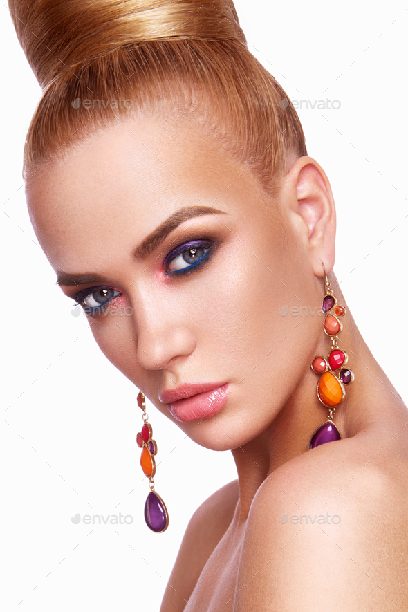 Beautiful woman with colored makeup. - Stock Photo - Images