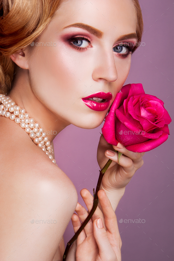 Lady with pink rose. - Stock Photo - Images