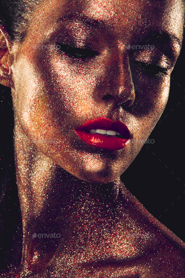 Beautyful girl with gold glitter on her face - Stock Photo - Images