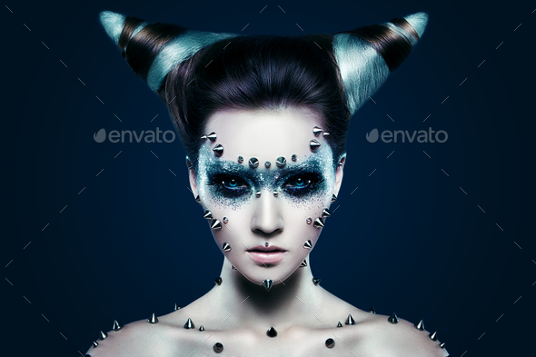 Demon girl with spikes on the face and body - Stock Photo - Images