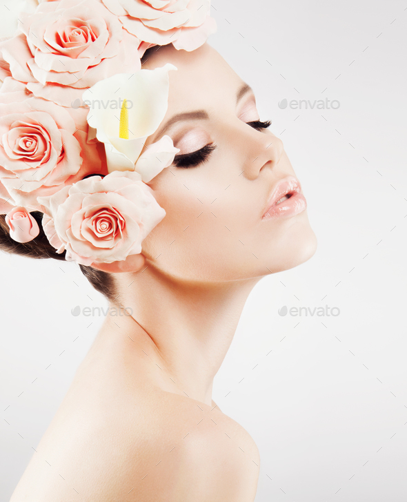 Beautiful girl with a wreath of flowers - Stock Photo - Images
